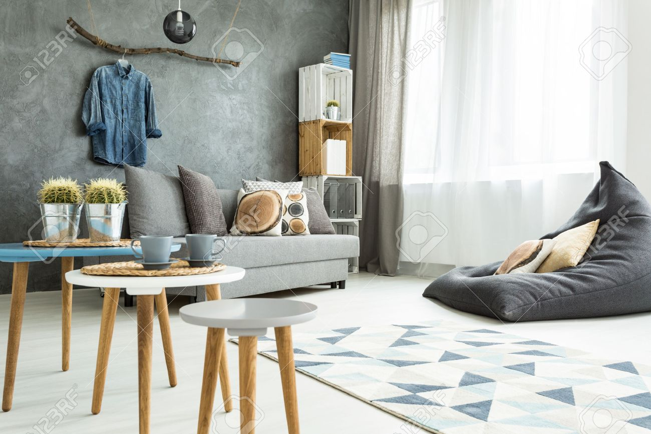 modern minimalistic and bright living room in shades of cyan with sofa bean bag chair - Cyan Living Room Decor