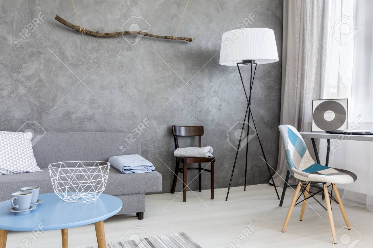 . Grey interior of a cosy living room  with two cups of coffee