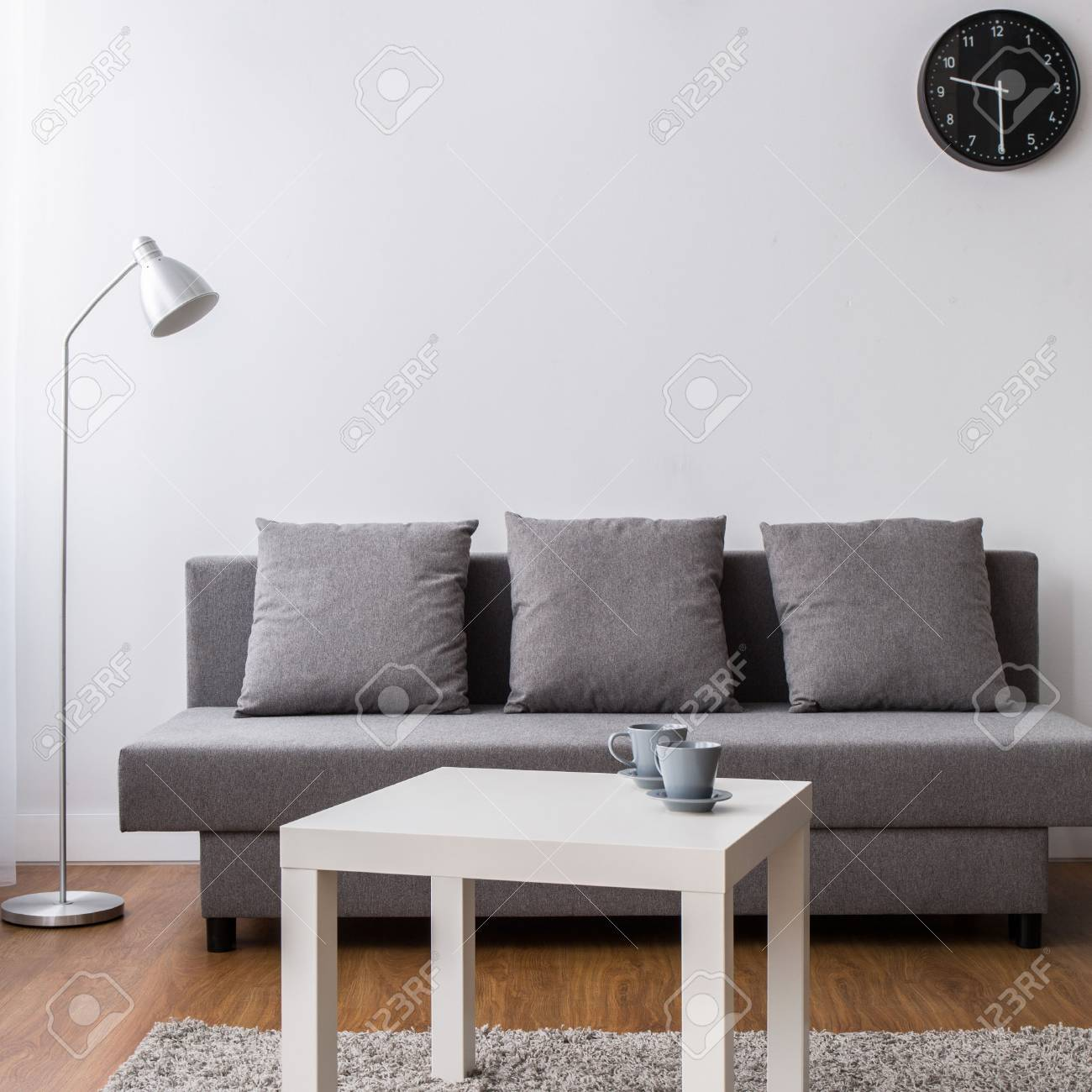 New Living Room With Comfortable Sofa, Small Table And Black.. Stock ...