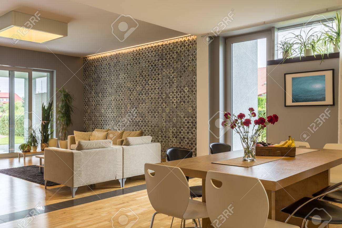 modern house in beige with living room and dining area combined rh 123rf com Living Room and Dining Room Colors Simple Living Room Decorating Ideas