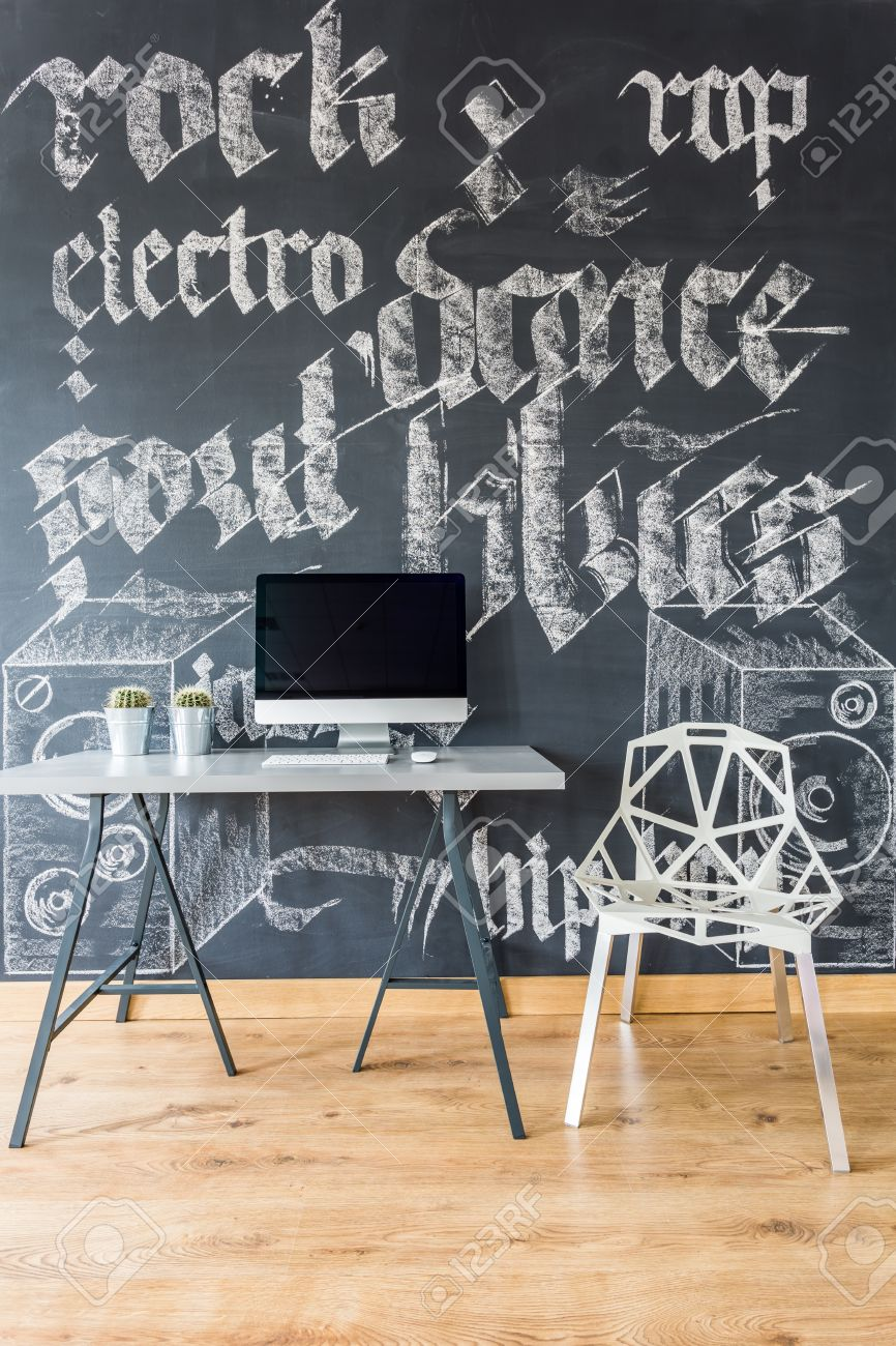 Creative Home Office With Chalkboard Wall, Simple Desk. Computer And White  Crystal Chair Stock