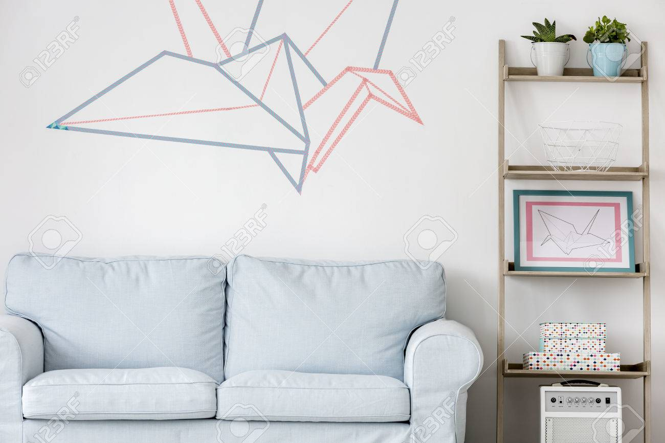 Light living room with sofa diy regale and washi tape wall decor light living room with sofa diy regale and washi tape wall decor stock photo aloadofball Image collections