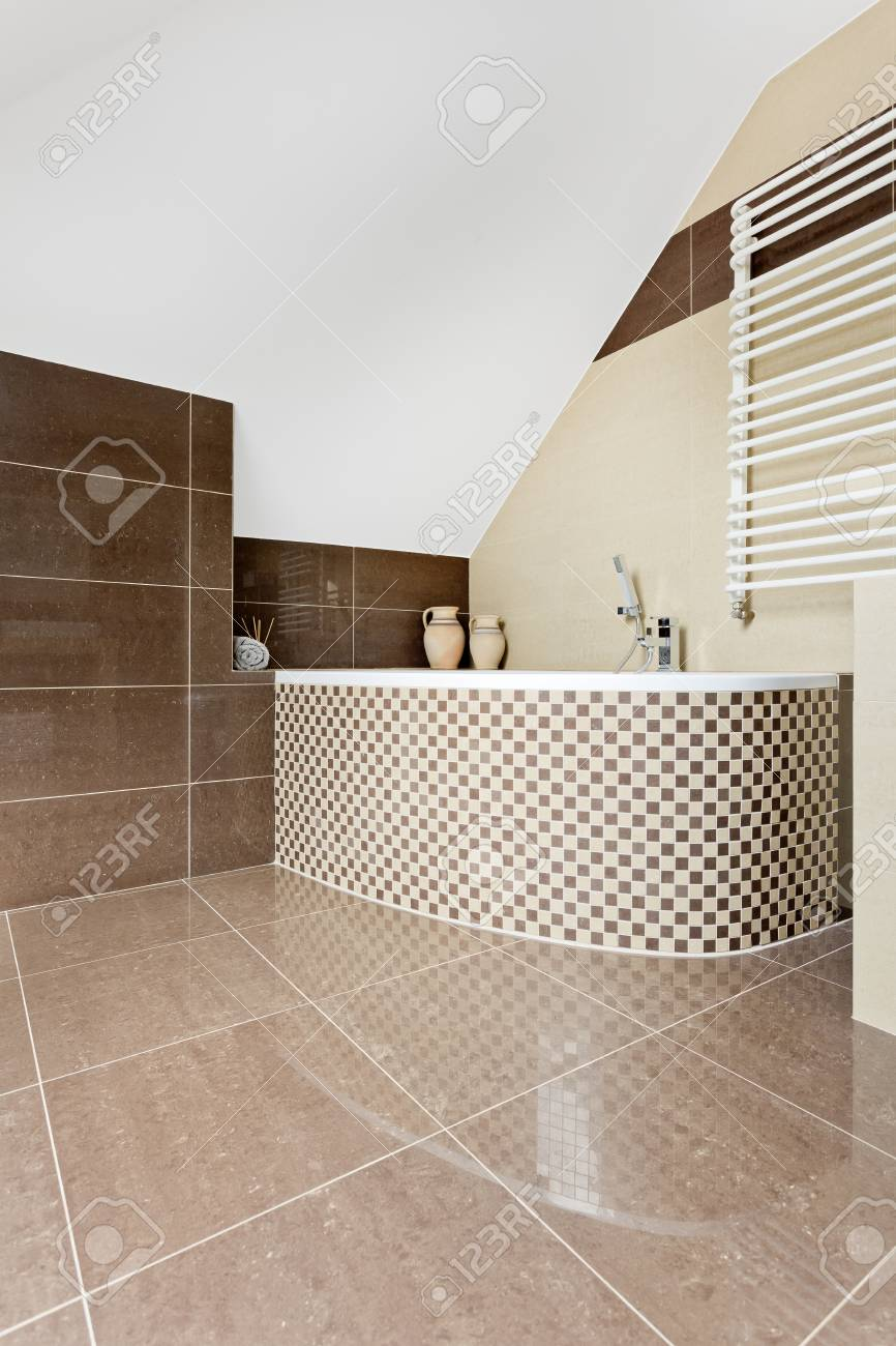 Modern Bathroom With Brown Tiling And Mosaic Tile Bathtub Stock ...