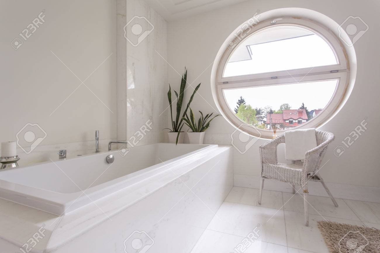 Attirant Big Round Window In Bright Tiled Bathroom Design Stock Photo   63645496