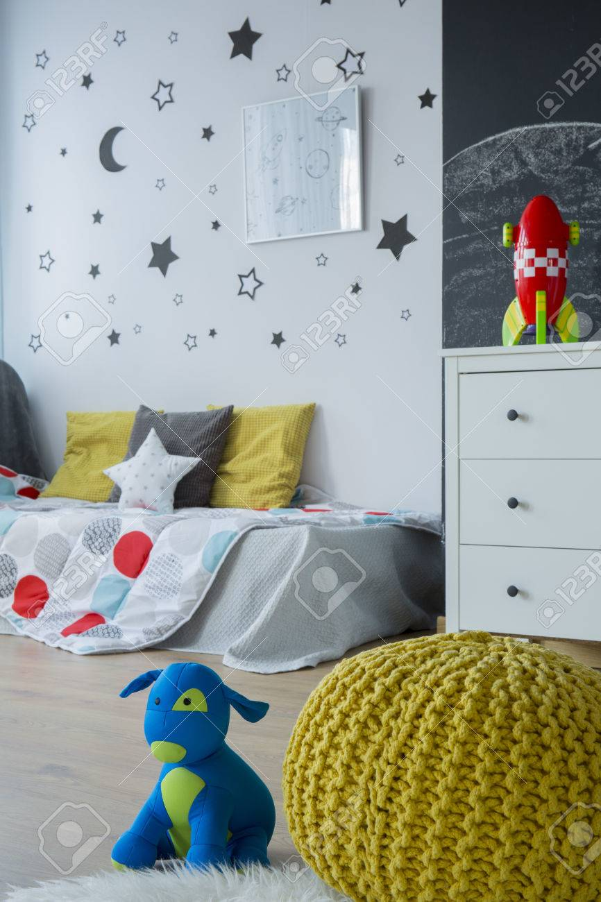 Modern Child Room With White Dresser, Single Bed, Yellow Pouf ...