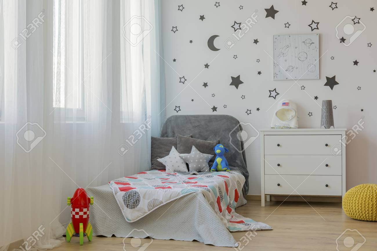 Light Child Bedroom With Single Bed And Star Wall Decor Stock Photo Picture And Royalty Free Image Image 63723053