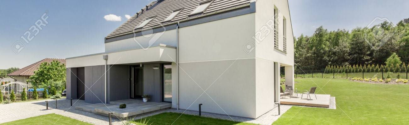 Doppelgarage modern  Exterior View Of A Modern House With Garage, Patio And Garden ...