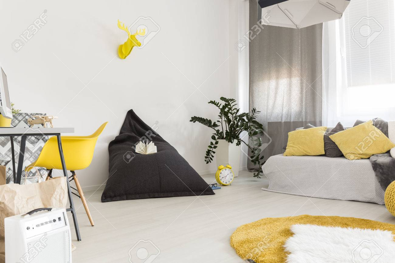 Modern Flat With Yellow Chair, Simple Desk, Sack Chair, Carpet ...