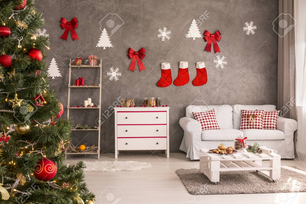 photo modern and spacious living room with decorated christmas tree and diy wall decor