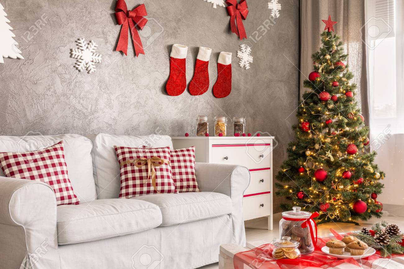 photo modern living room in grey and white with christmas tree and diy wall decor