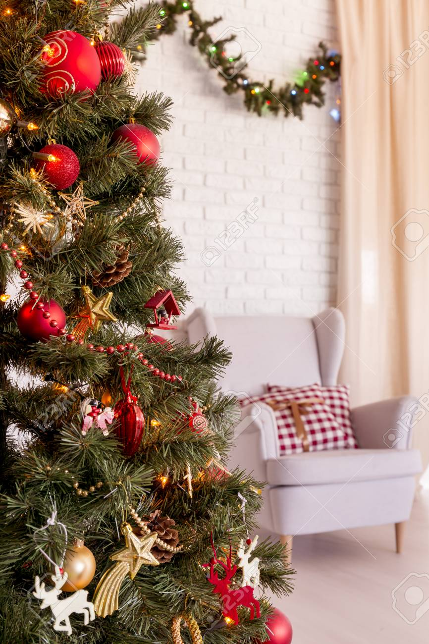 Traditional Red And Gold Christmas Tree In Light Living Room Stock Photo Picture And Royalty Free Image Image 64788522