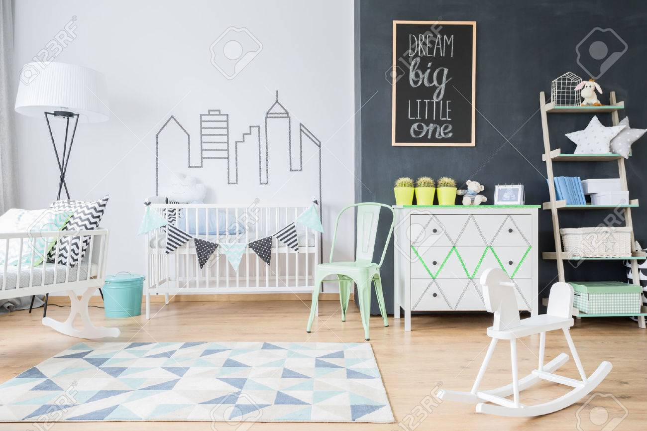 Shot of a spacious child's room interior with a blue and white rug Standard-Bild - 64791532