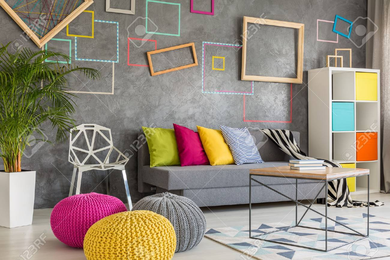 Colorful Living Room With Decorative Grey Wall And Wool Poufs Stock Photo    64791747