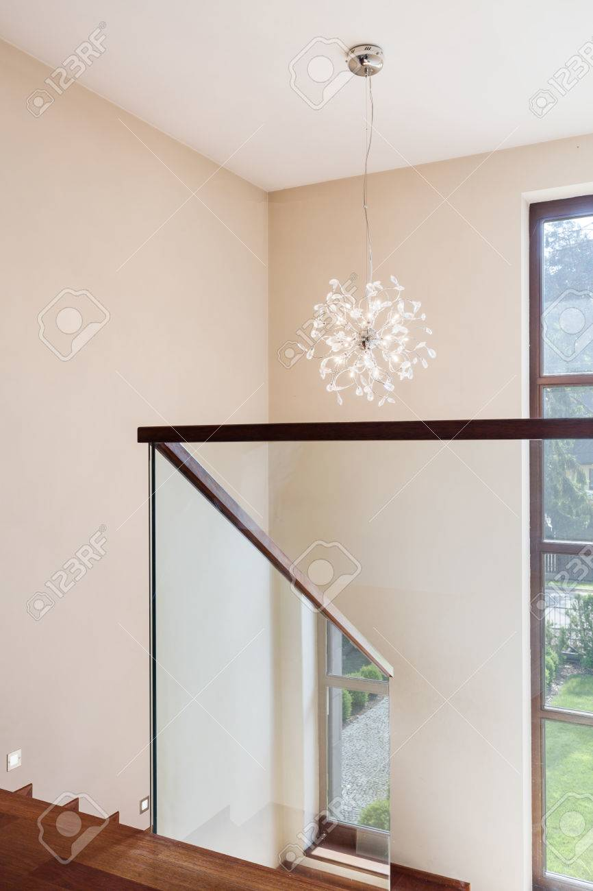 Bright corridor close to the stairs with minimalistic handrail bright corridor close to the stairs with minimalistic handrail and the chandelier stock photo 65139330 arubaitofo Image collections