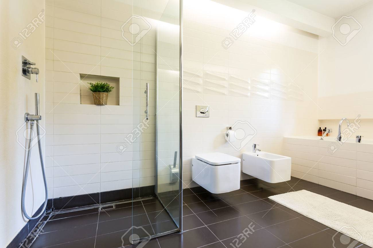 Tiled Bathroom Interior With The Toilet And Urinal In Rectangular ...
