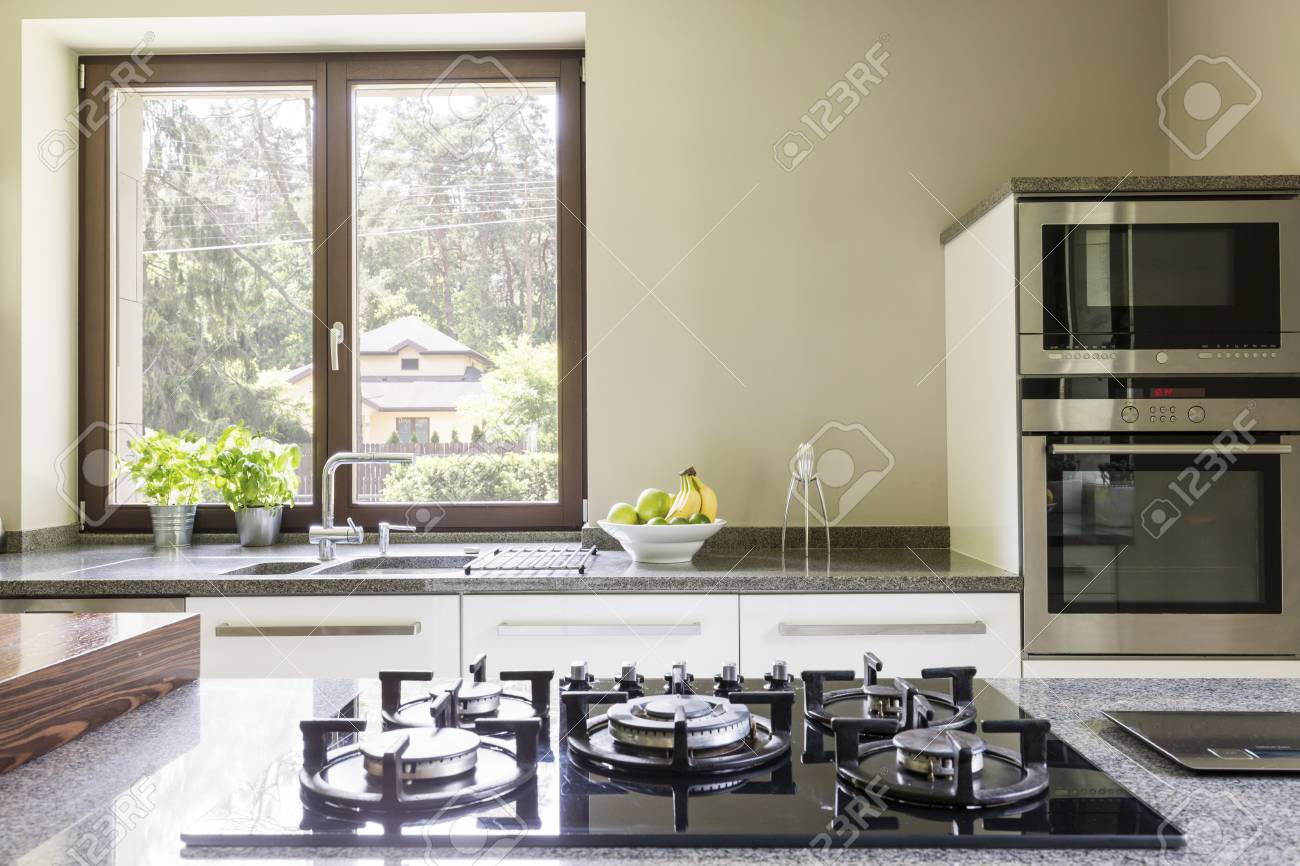 Kitchen Granitic Worktop With A Cooker And The Kitchen Units.. Stock ...