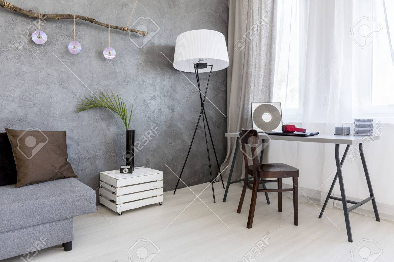 Image Of A Grey Living Room With Cement Wall Effect Sofa Floor Lamp
