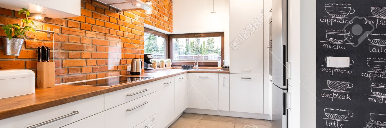 Bright And Clean Modern Minimalist Kitchen With White Cabinets Stock Photo Picture And Royalty Free Image Image 65558969