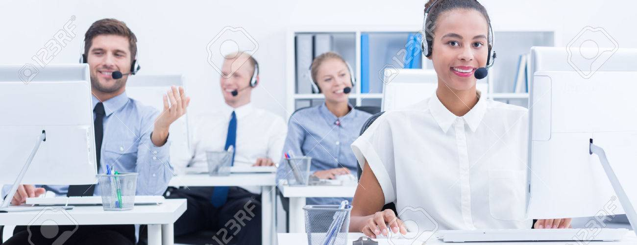 Bright work office area with satisfied employees Stock Photo - 66034564