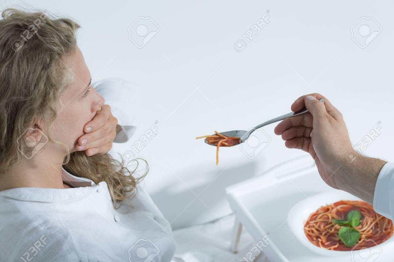 Shot of a teenage mental hospital patient rejecting food