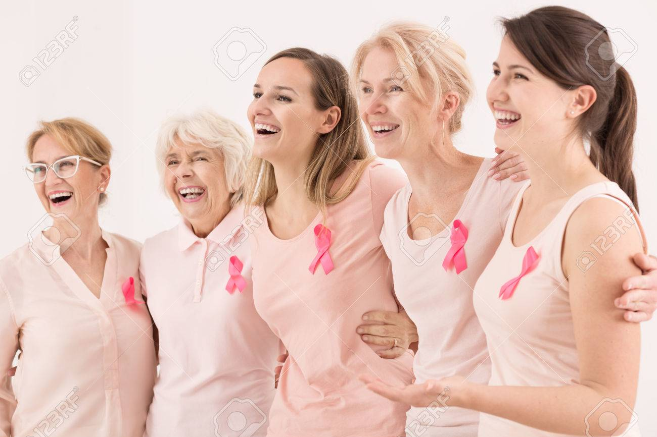 Happy breast cancer survivors supporting each other Stock Photo - 66120879