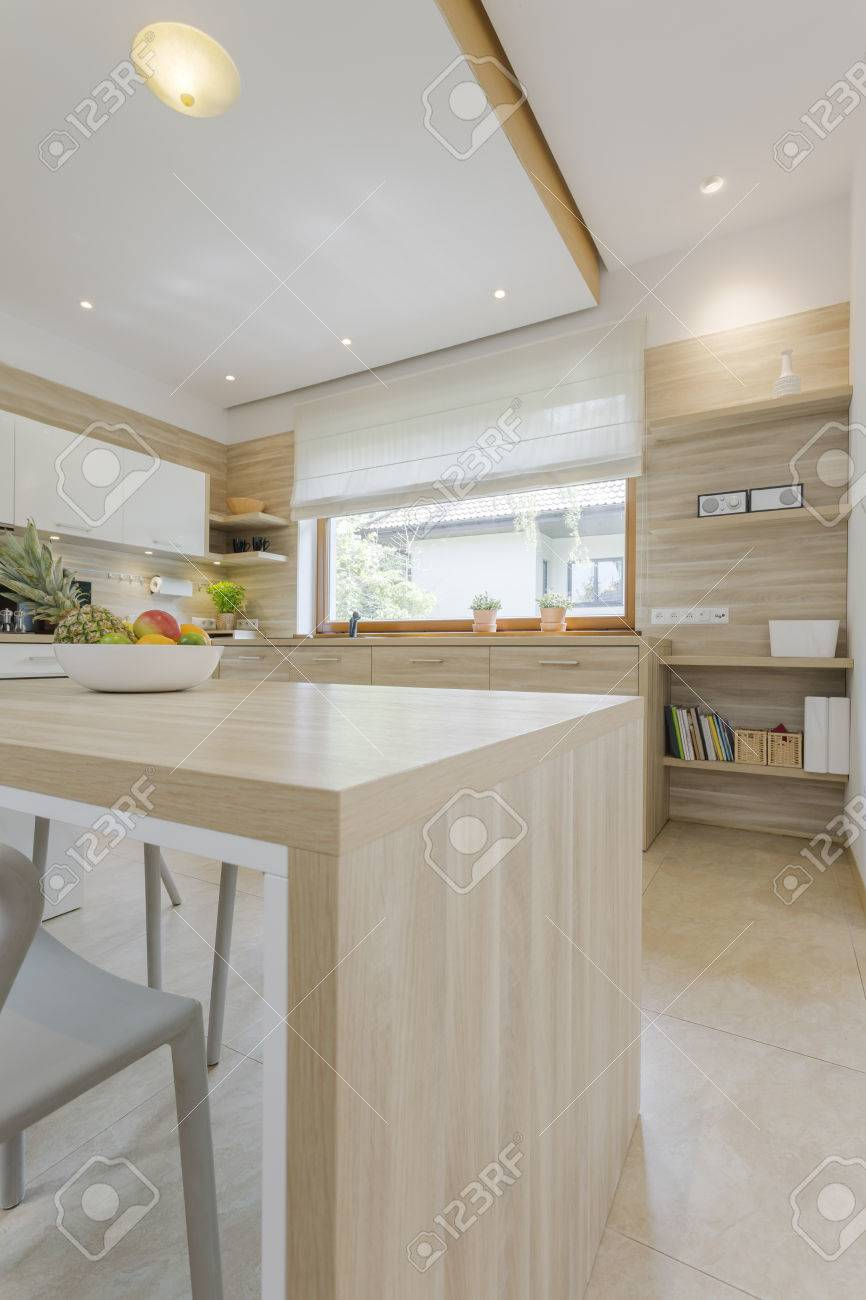 Bright Modern Kitchen With Furnishings Made Of Wood Resembling