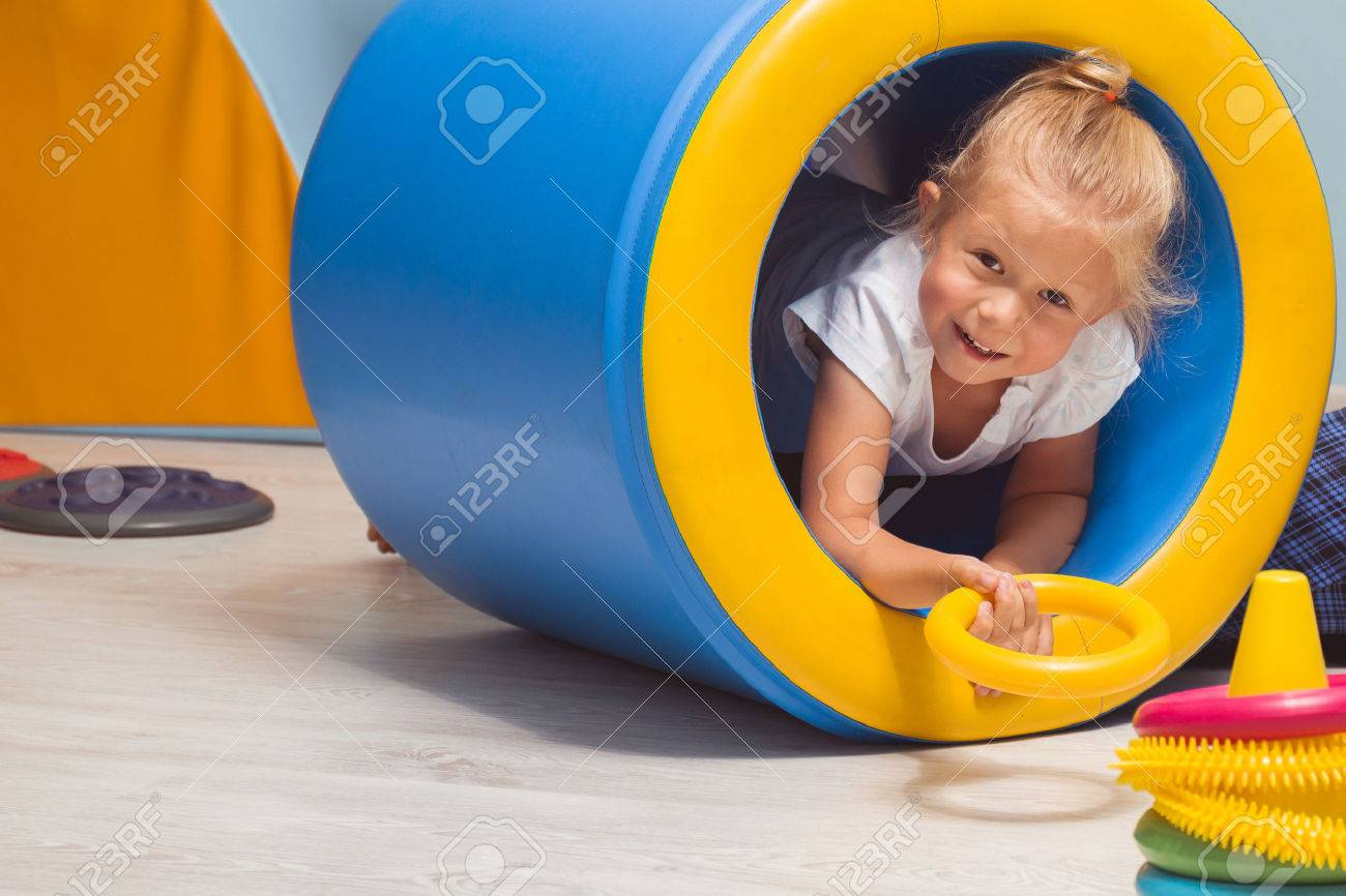 Chlid performing physical activities on  sensory integration class Stock Photo - 66556744
