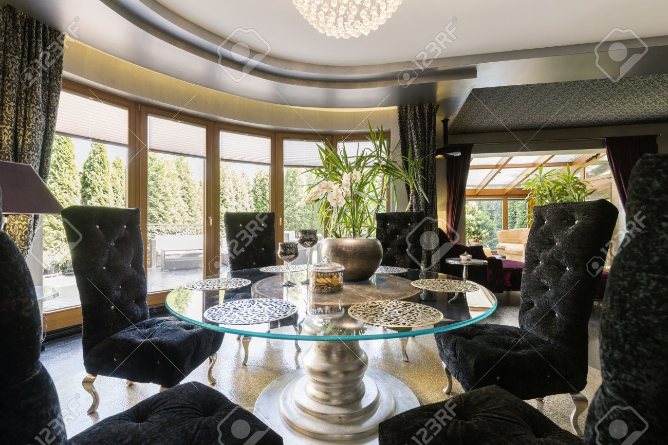 Stock Photo   Very Luxurious Dining Room With Round Glass Table And Black  Velvet Chairs