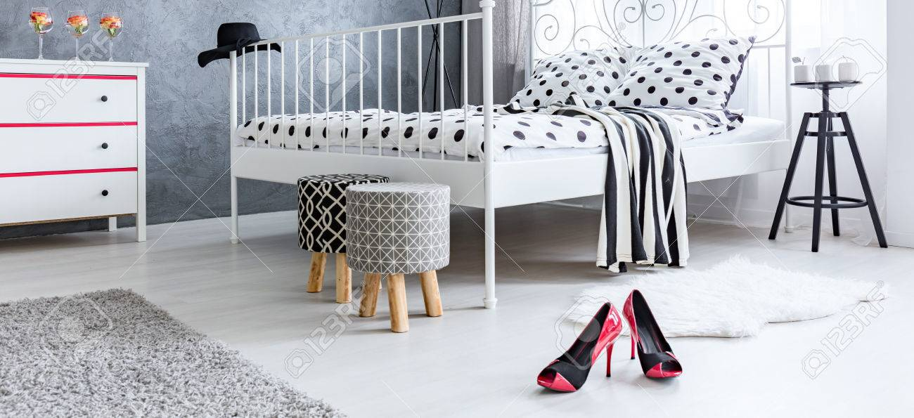 Red High Heels On The Floor Of Female Bedroom Stock Photo   67277847