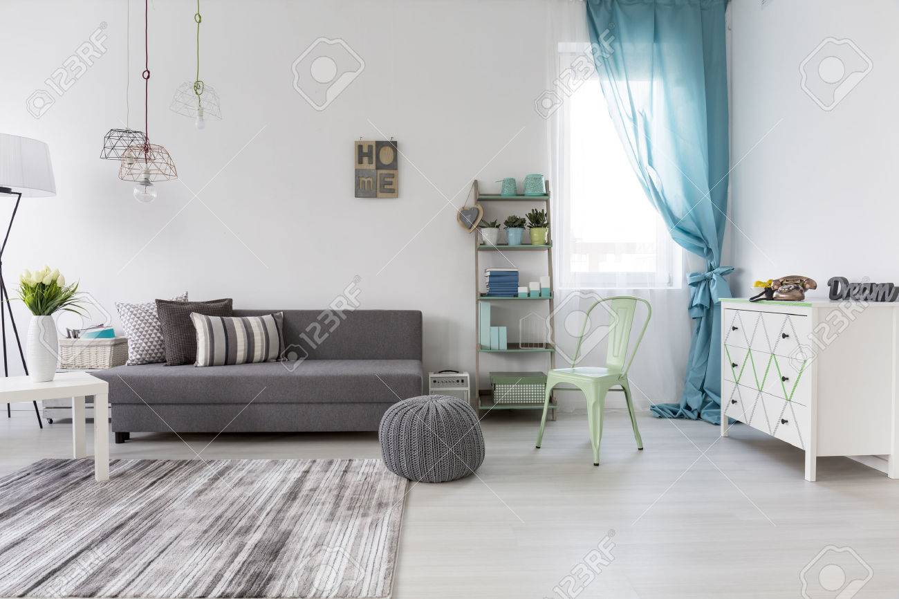 Bright Spacious Living Room With Comfortable Couch And Chest.. Stock ...