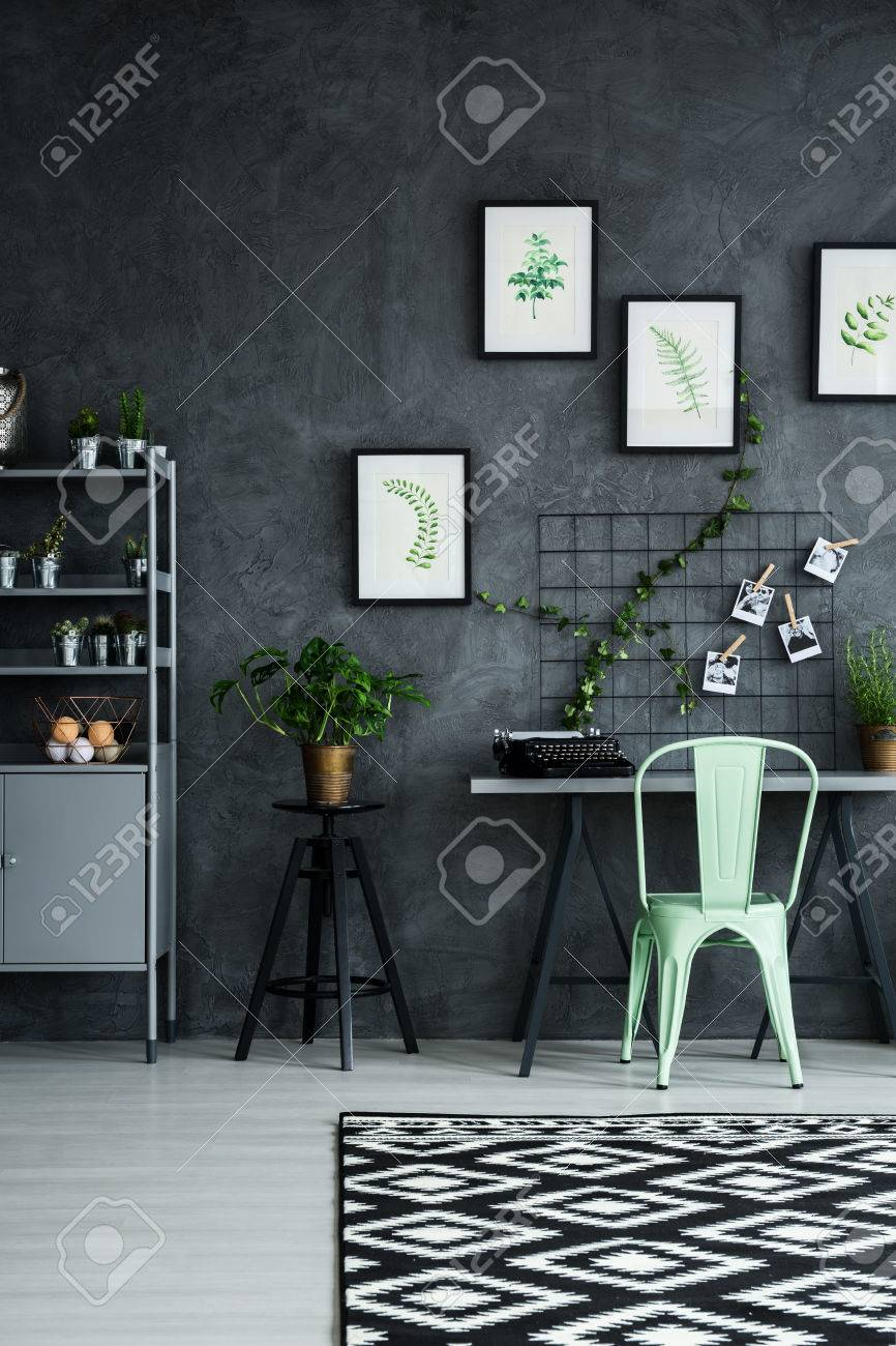 mint chair in modern apartment with cyan wall stock photo 68145324