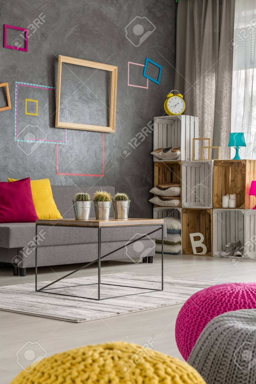 Close Up Of Colorful Poufs On The Floor In Modern Living Room Stock Photo