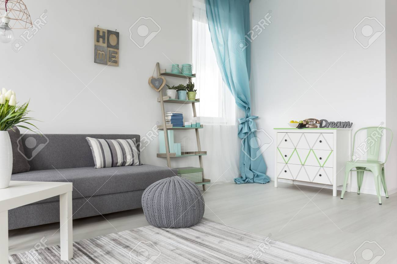 Living Room In Shades Of Gray And Pastel Colors With Sofa Bed ...