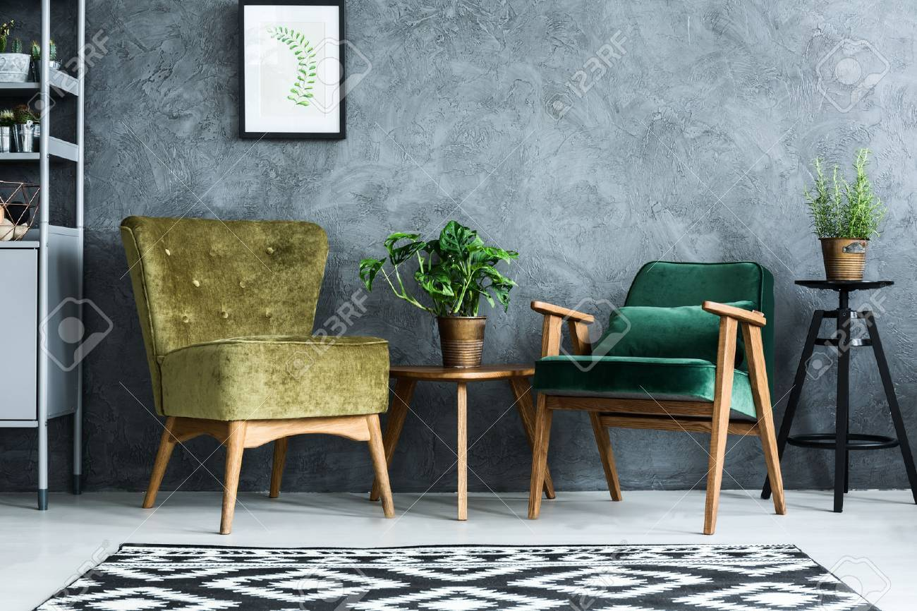 Apartment with modern armchairs and cyan wall Stock Photo - 68146823