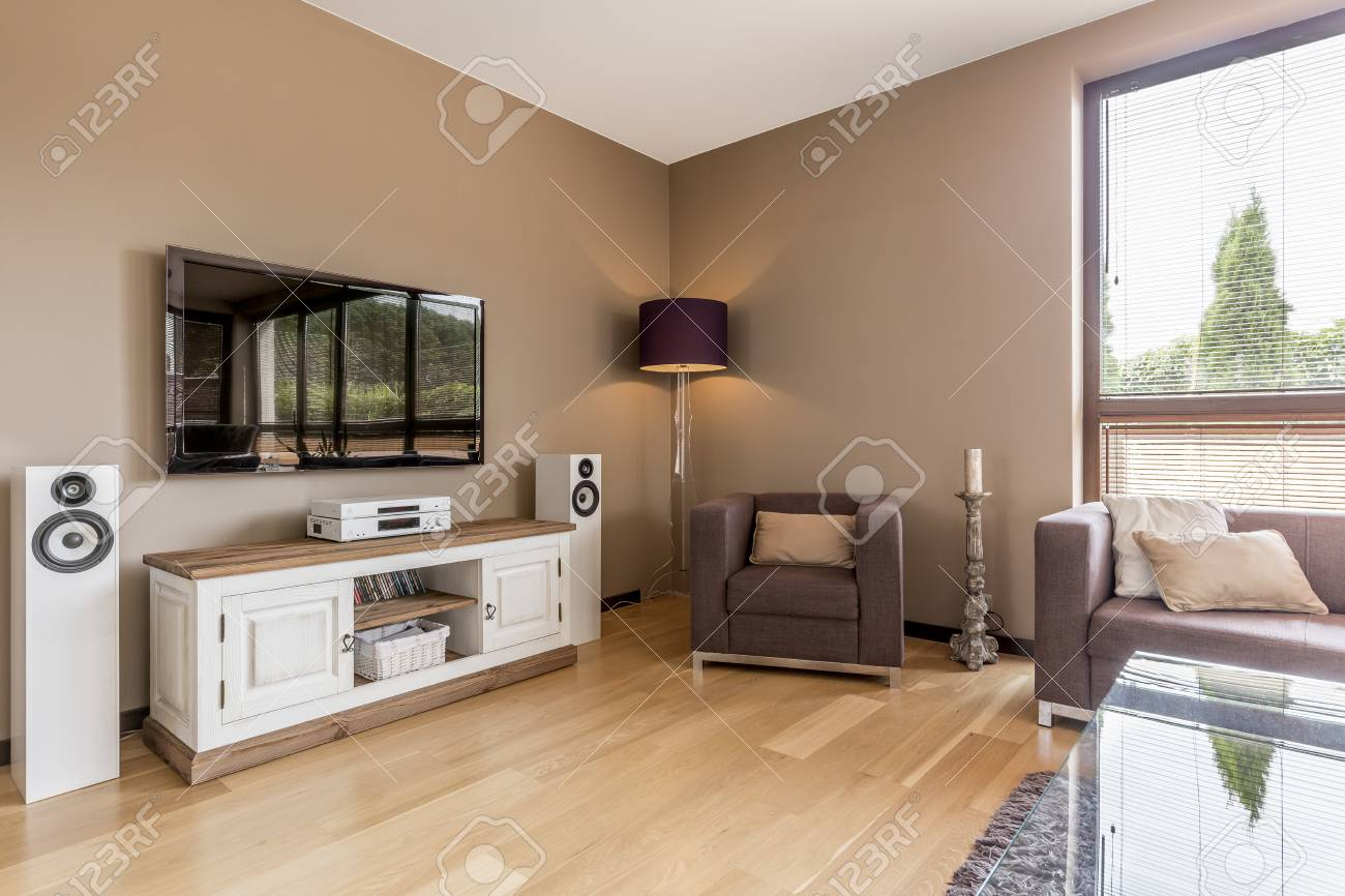 Shot Of A Cozy Modern Living Room With A Big Tv Stock Photo Picture And Royalty Free Image Image 68463578