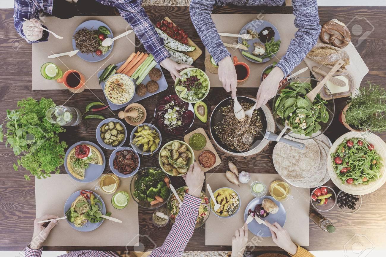 People enjoying family dinner at vegetarian restaurant Stock Photo - 68548803