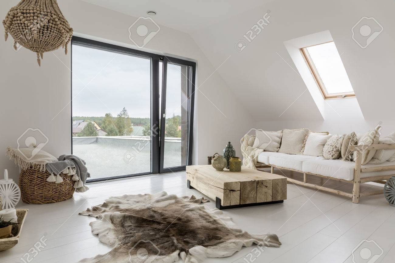 White Attic Room With Balcony And Wooden Decorative Accessories ...