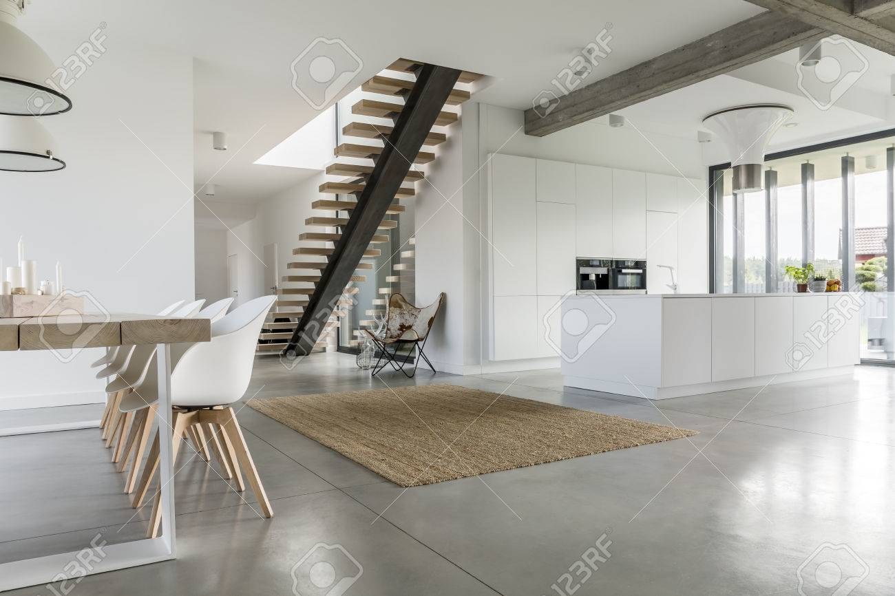 Open floor apartment with staircase, dining table and kitchen - 68553662