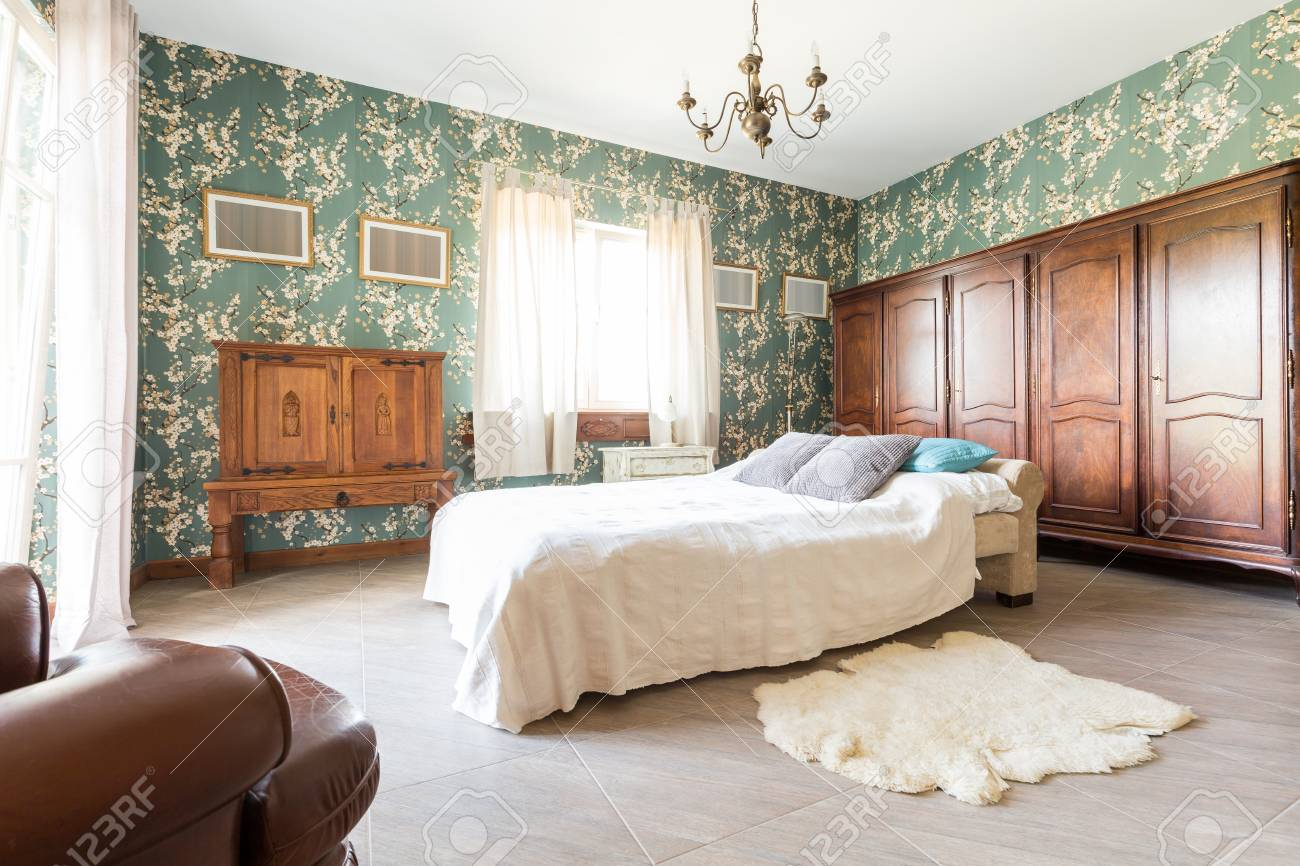 Double Bed And Wooden Furnitures In A Stylish Old-fashioned Bedroom ...