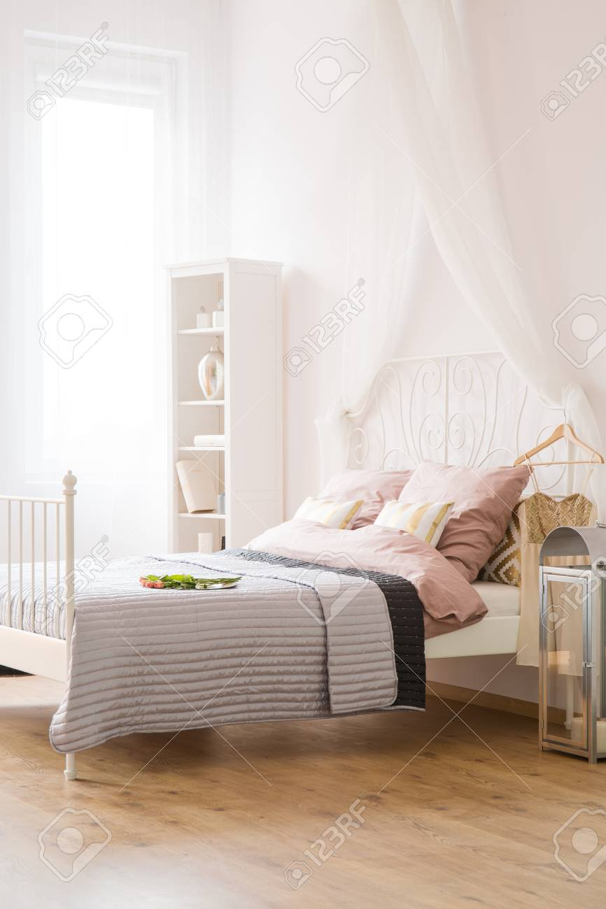 - White Bedroom With Bed, Canopy, Window And Bookcase Stock Photo