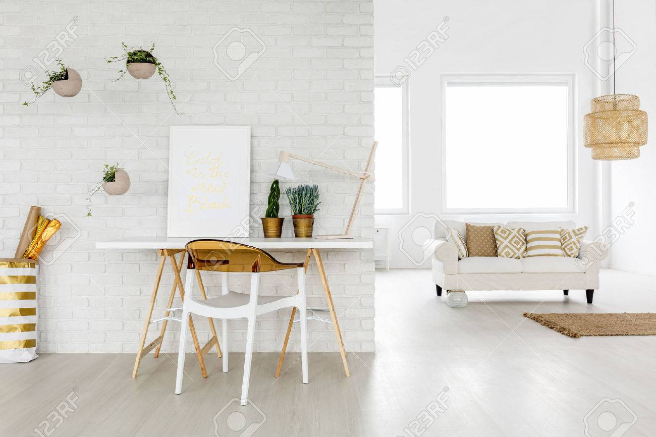 Bright loft apartment with working area and sofa Standard-Bild - 68553879