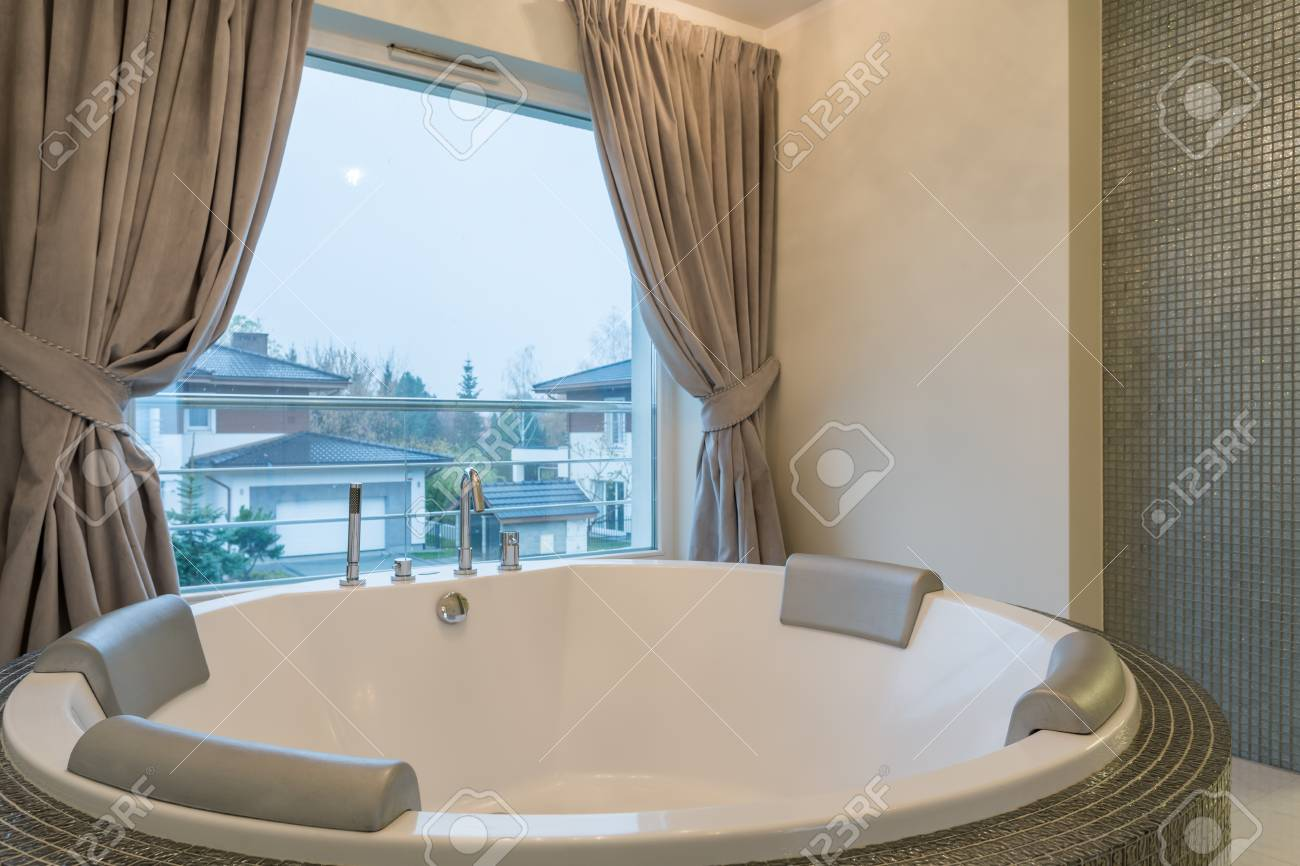Well-lighted Bathroom With Luxurious Jacuzzi Stock Photo, Picture ...