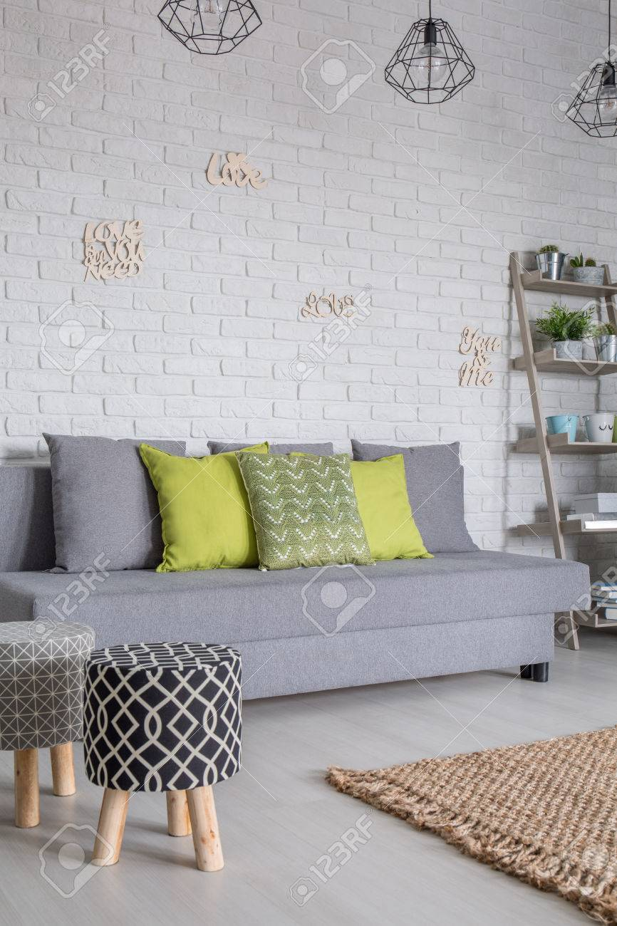 Living Room With Sofa And Upholstered Stools Stock Photo, Picture ...