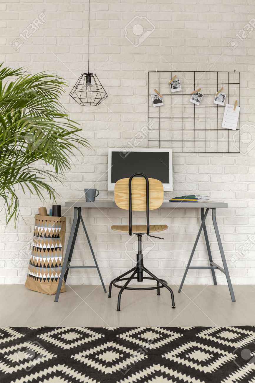 Home Office In Industrial Style With Simple Desk And Rug Stock Photo