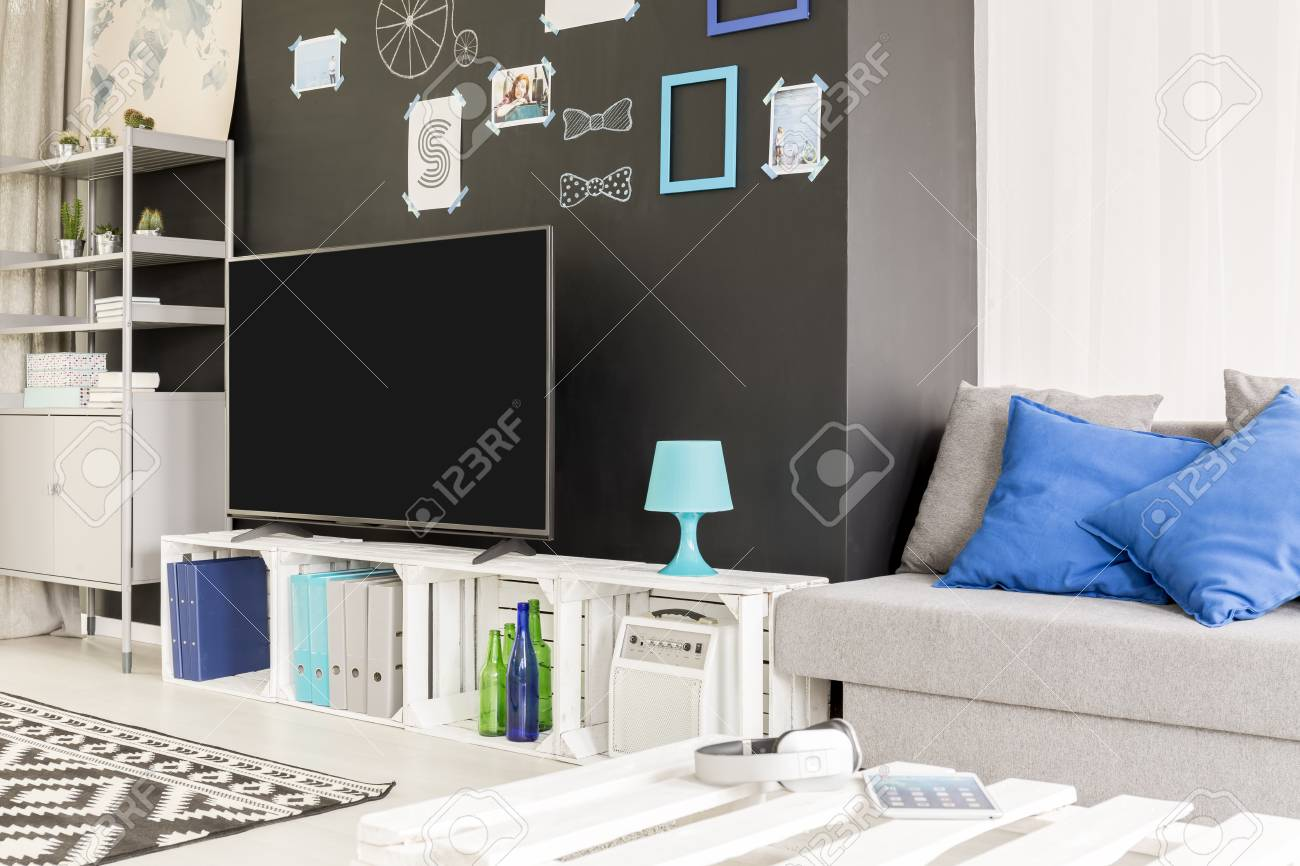 Black And White Room With Metal Bookcase Tv And Sofa Stock Photo  # Meuble Tv Ypster