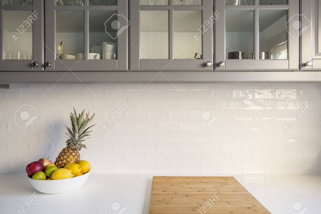 Kitchen With White Worktop Grey Furniture And Brick Tiles Stock Photo Picture And Royalty Free Image Image 70236622