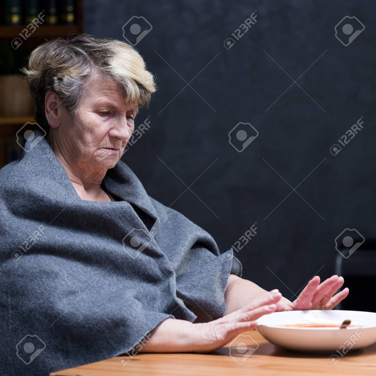 Depressed elderly woman refusing to eat healthy meal Banque d'images - 70236633