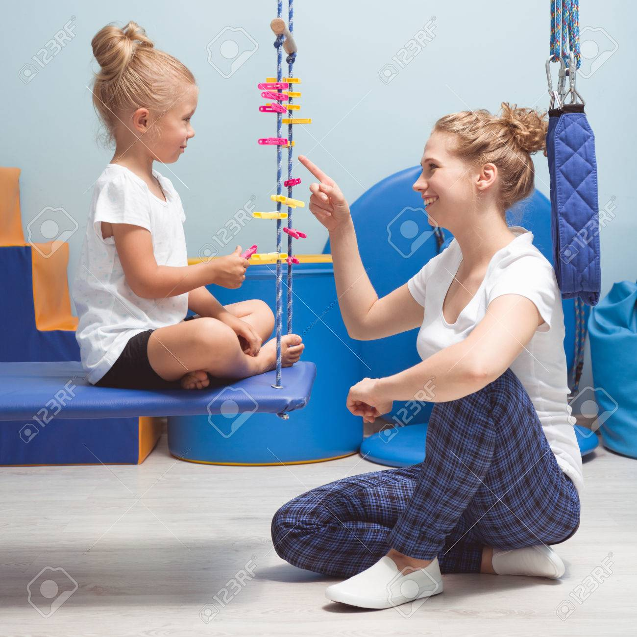 Physical and mental activities for a kid during sensory integration therapy - 70962814