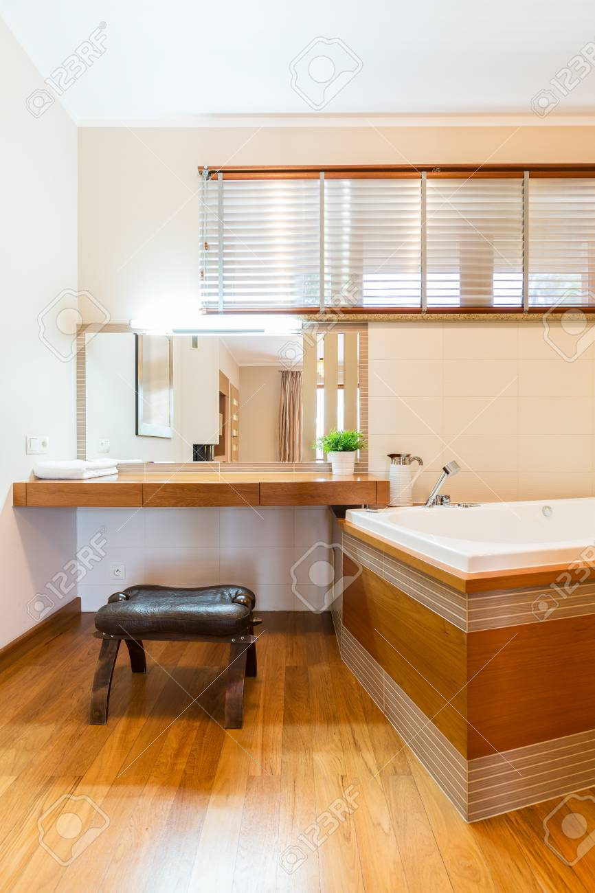 Modern Bathroom With Bathtub Mirror Make Up Vanity Table And Stock Photo Picture And Royalty Free Image Image 70962825