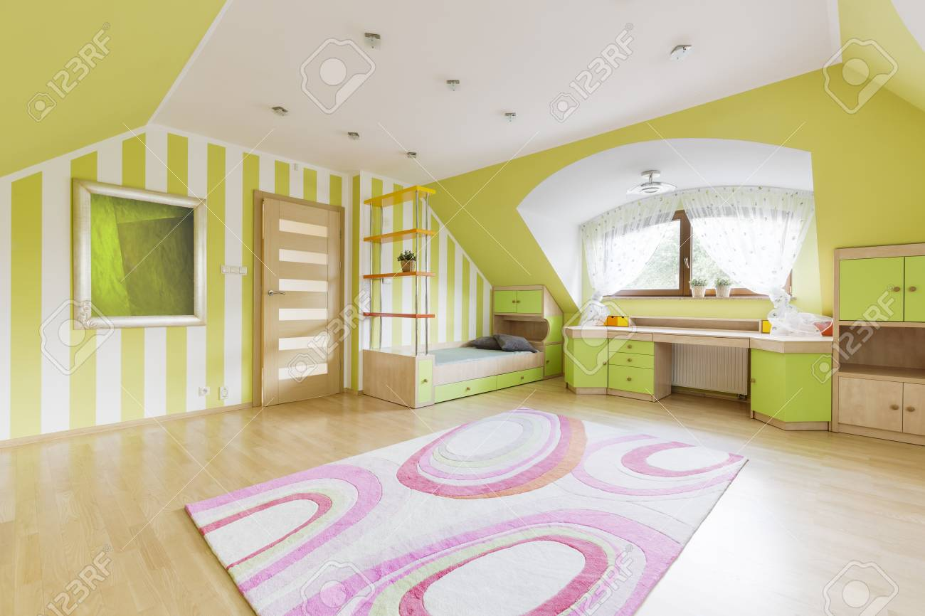 Green Room With Striped Wallpaper Bed Desk And Wide Window